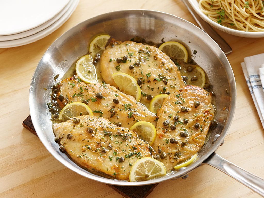 This is an easy weeknight recipe that takes thinly sliced chicken breasts and pairs them with a light lemon sauce- perfect for serving along side a bed of pasta!